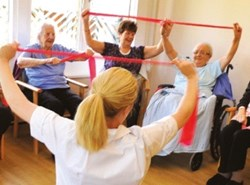 Elderly residents exercising with resistance bands